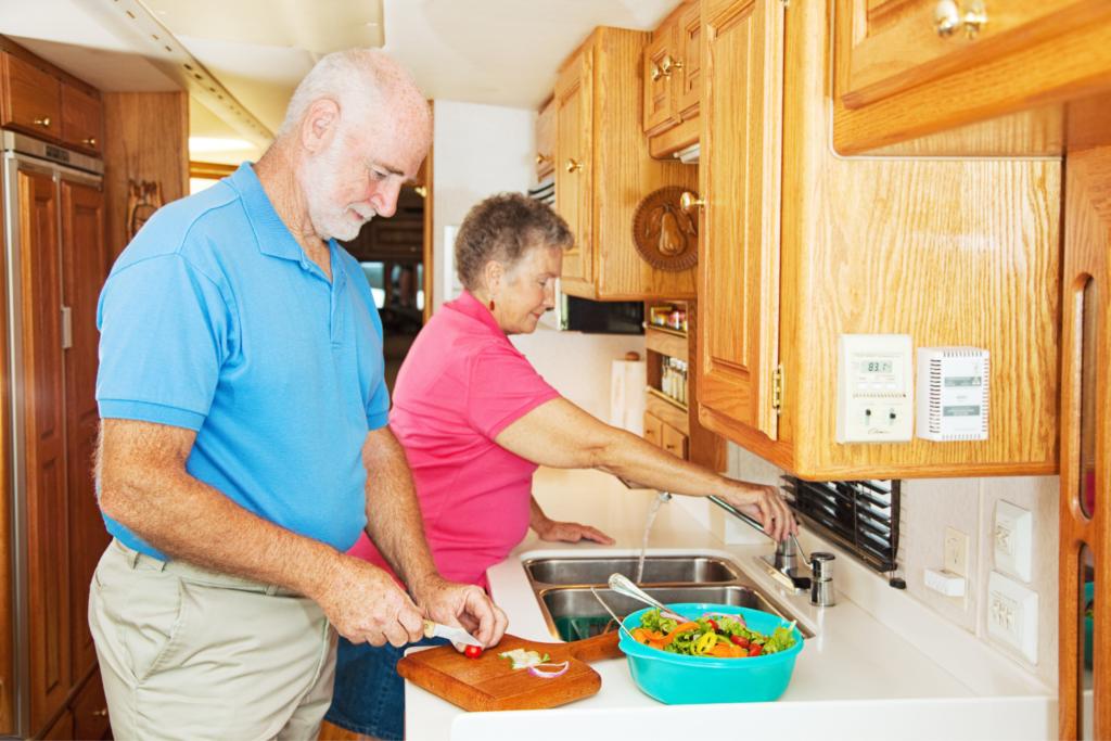 couple in RV kitchen