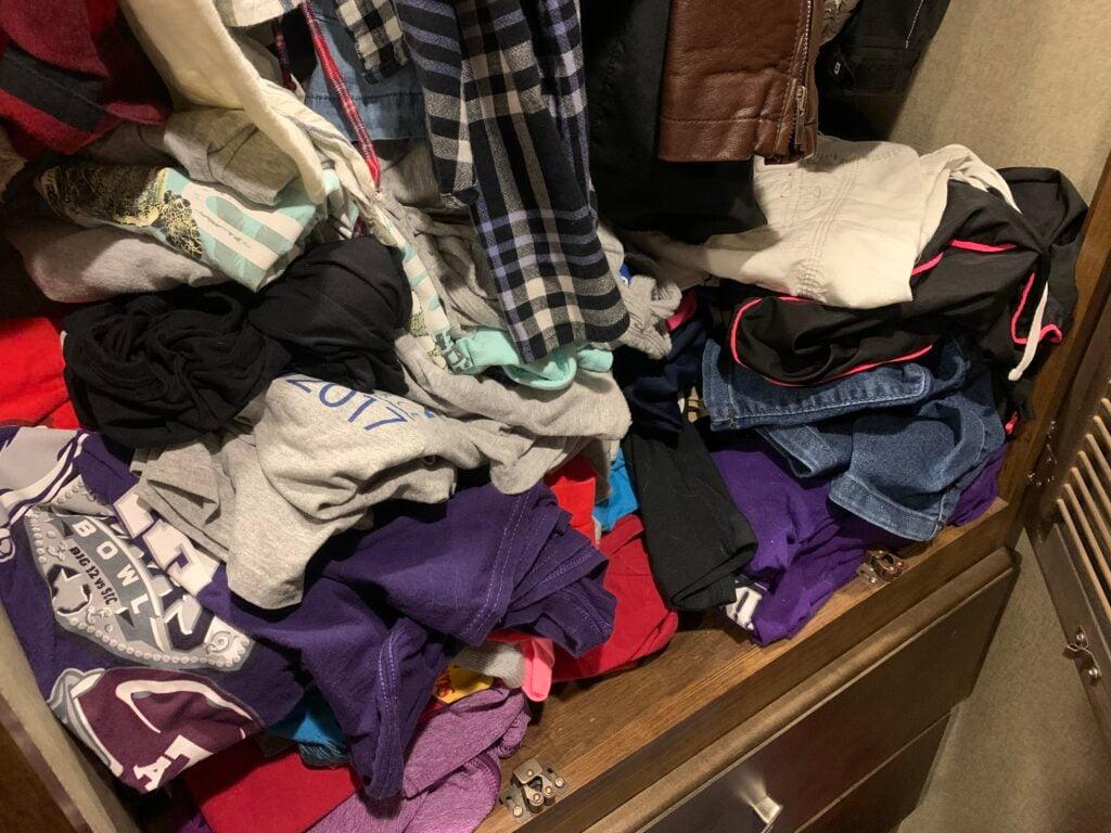 clothes pile in an RV closet