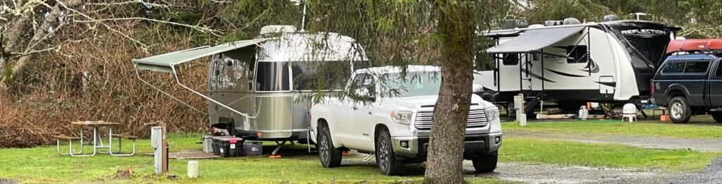 truck and Airstream parked at RV campsite