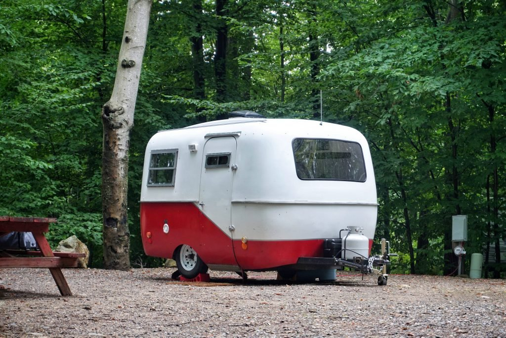 small red and white camper trailer