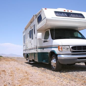 Class C RV parked on road