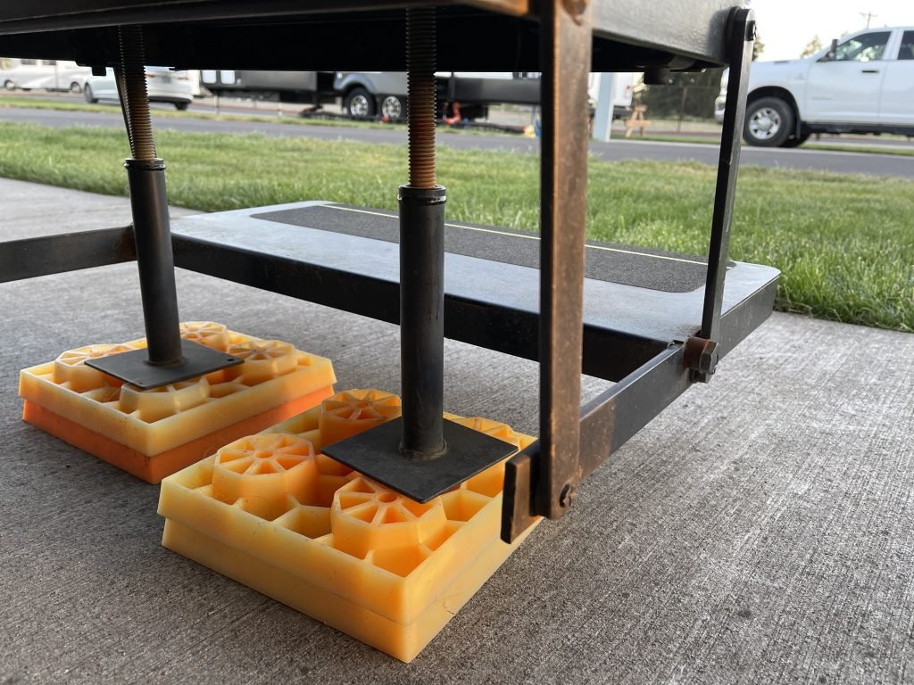 View from behind the RV entry steps, showing how step braces are installed to protect your RV steps
