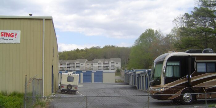 motorhome pulling up at RV and boat storage facility