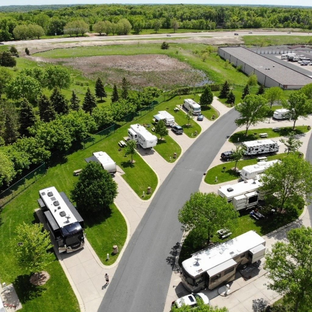 Aerial view of RV park with green grass