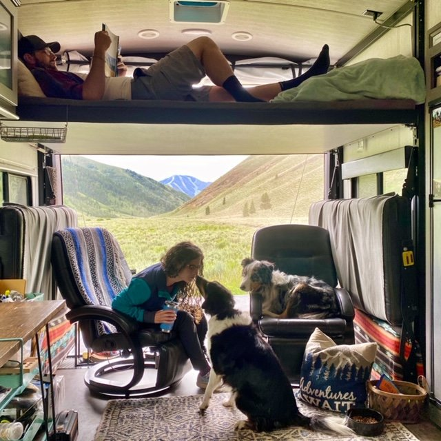 Couple relaxing in toy hauler trailer - adventure RV nomads