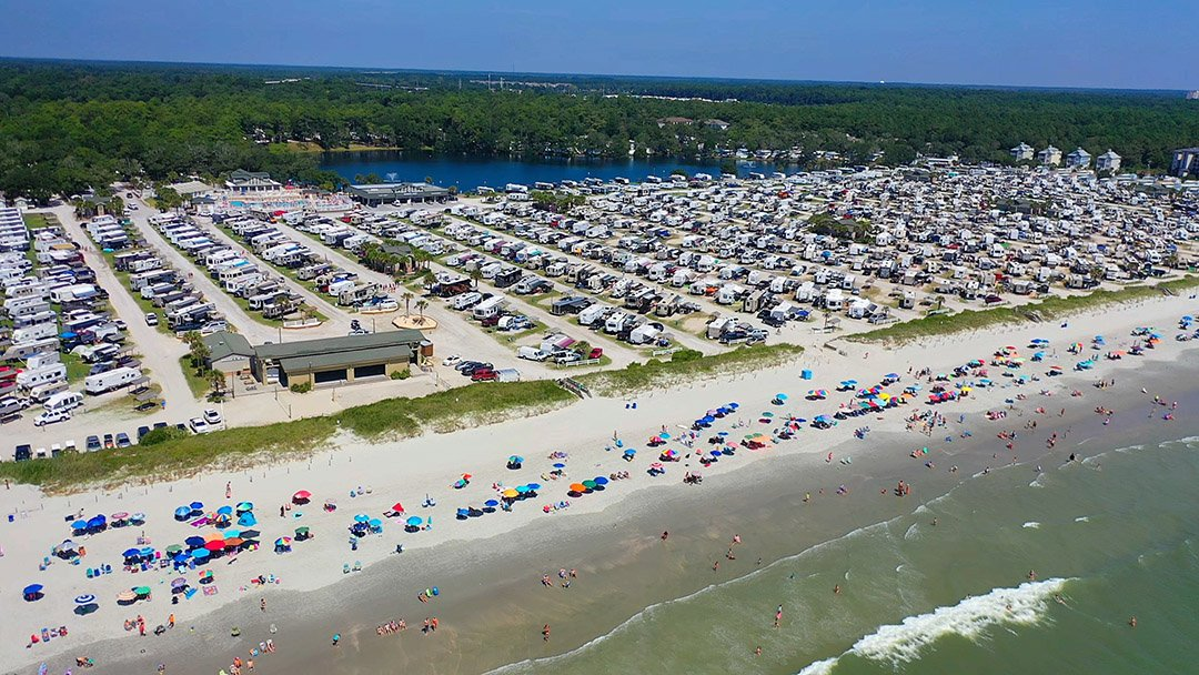aeria lview of a beach with campers