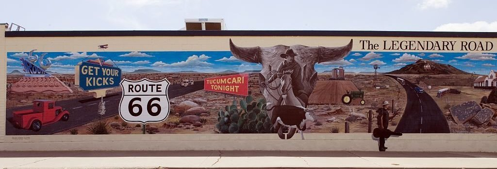Mural depiction of Route 66 with sign Get Your Kicks on Route 66 and cow skull.