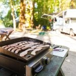 cooking breakfast at an RV site