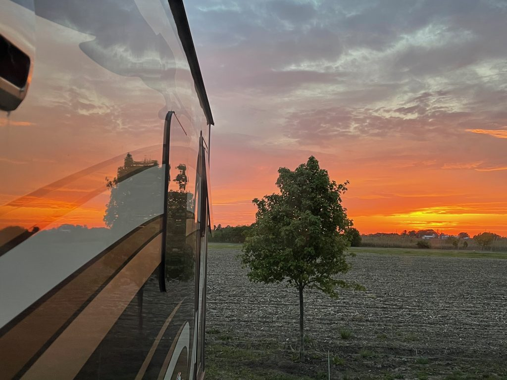 Red sky reflected in the side of the RV
