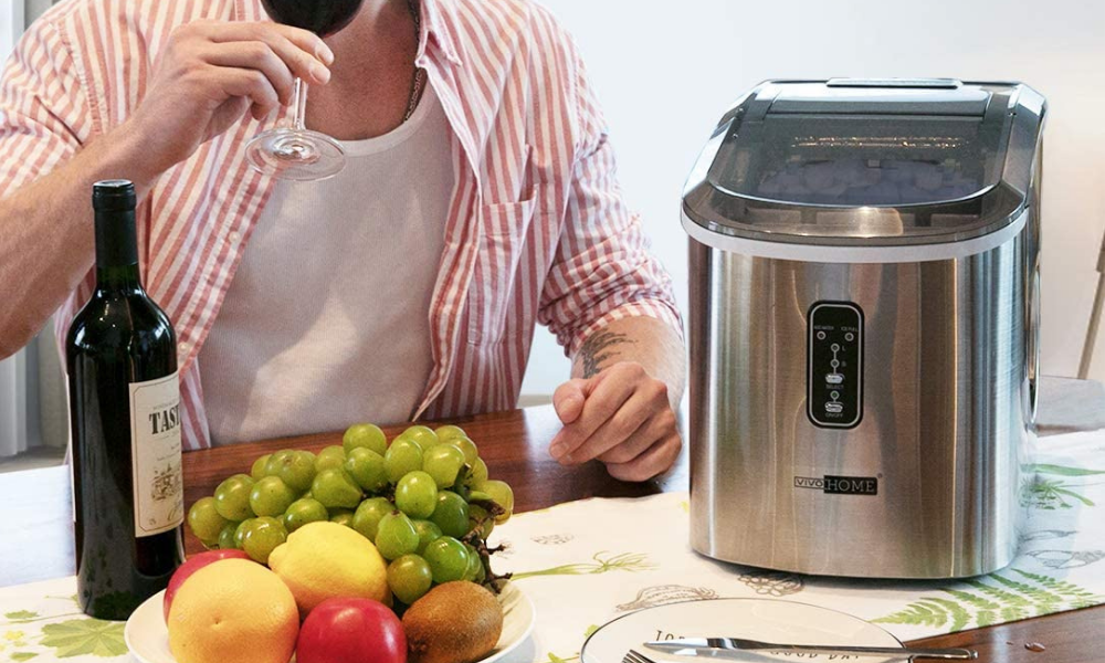 stainless steel ice maker on table beside fruit and wine - portable ice maker