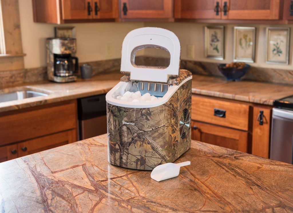 camo print ice maker with scoop on kitchen counter - portable ice maker