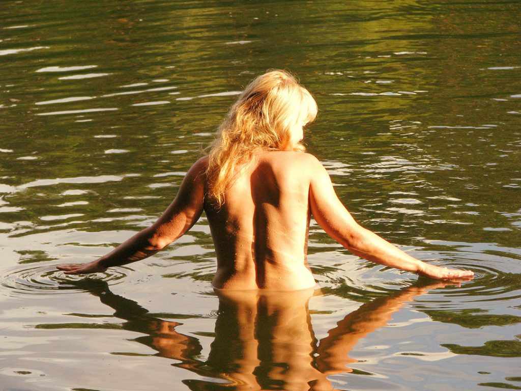 person bathing at a nudist RV park