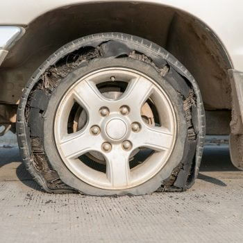An RV Tire blowout showing shredded tire.
