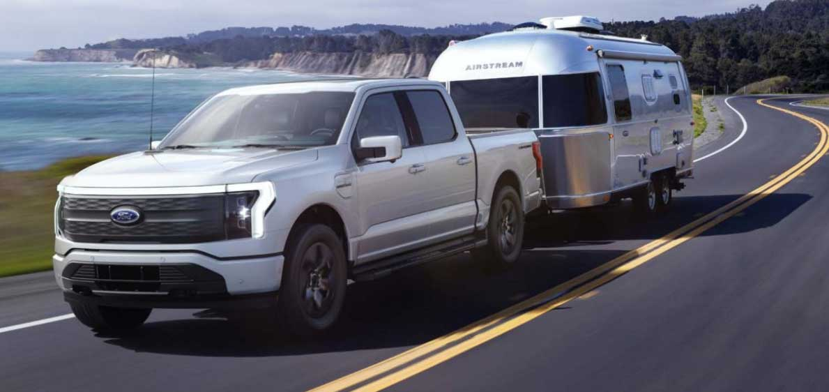 2022 Ford F150 Lightning electric truck towing Airstream trailer on highway