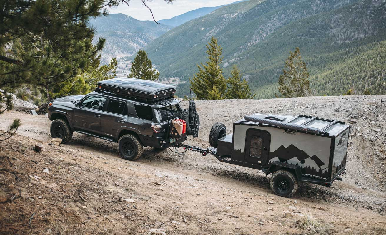 SUV on mountain road towing Boreas Campers Offroad Trailer