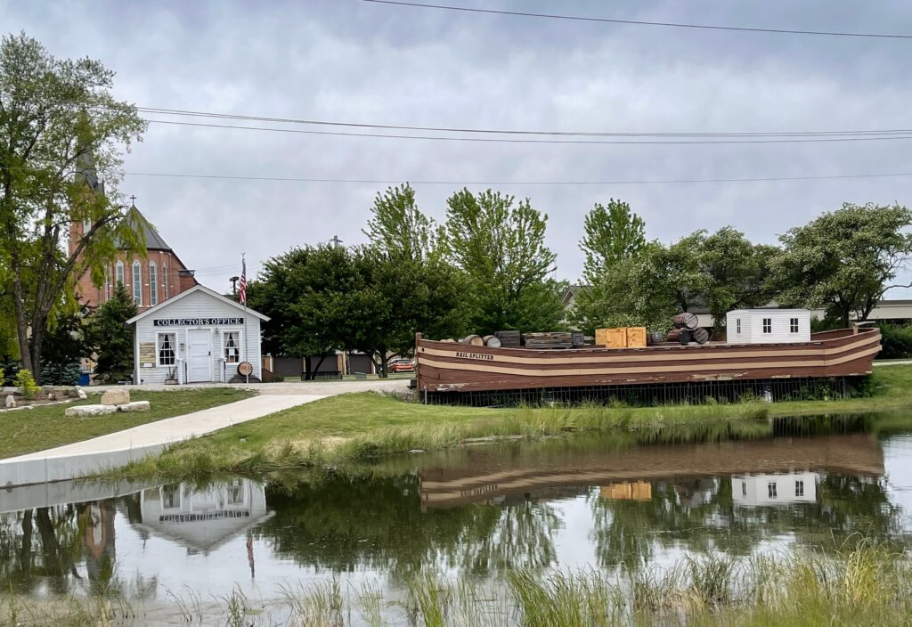 a canal barge is displayed along the I&M Canal near the historic toll house museum. - seen while RV camping near Ottawa