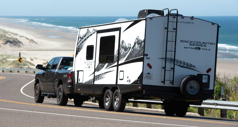 Ram 1500 pickup truck towing Backcountry Series MTN TRX travel trailer