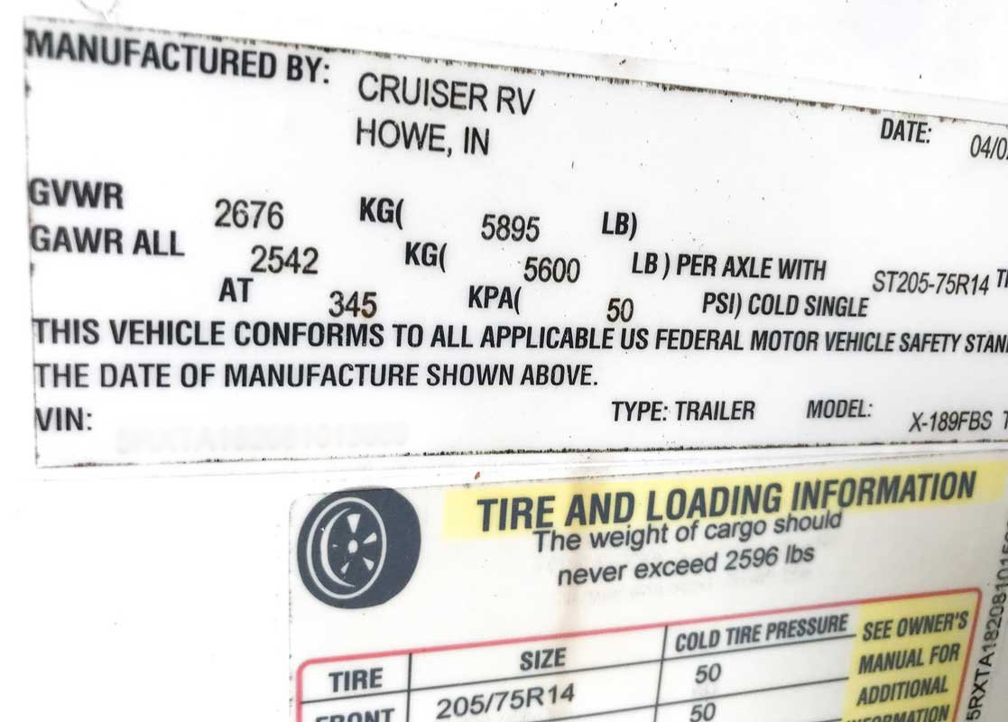 RV travel trailer sticker with gross vehicle weight rating information