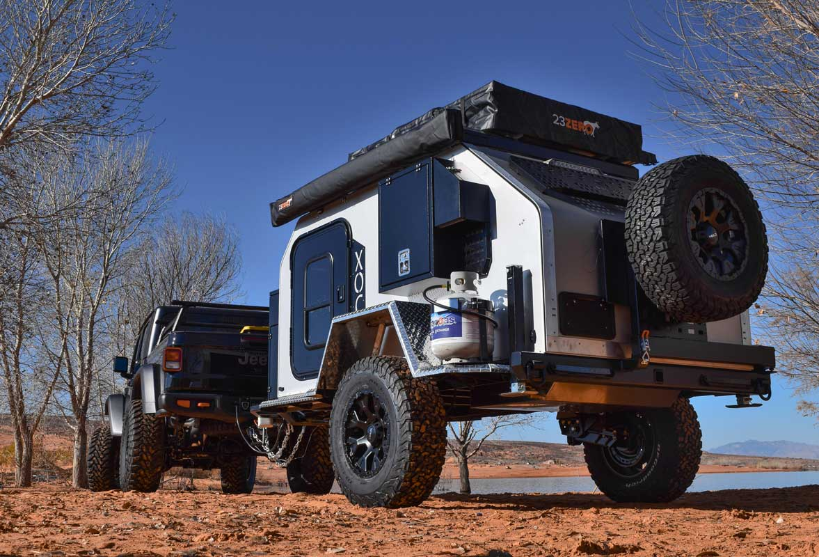 Jeep Gladiator towing Vorsheer XOC small trailer near water