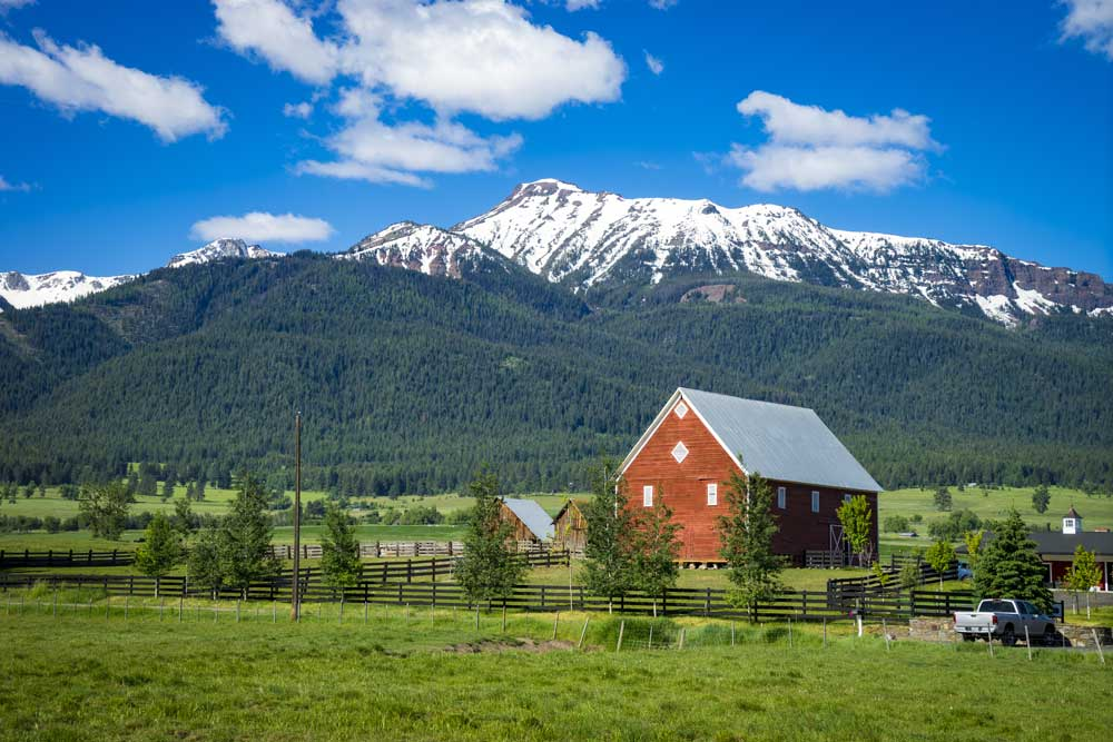 red barn and snowcapped Wallowa Mountains in northeastern Oregon