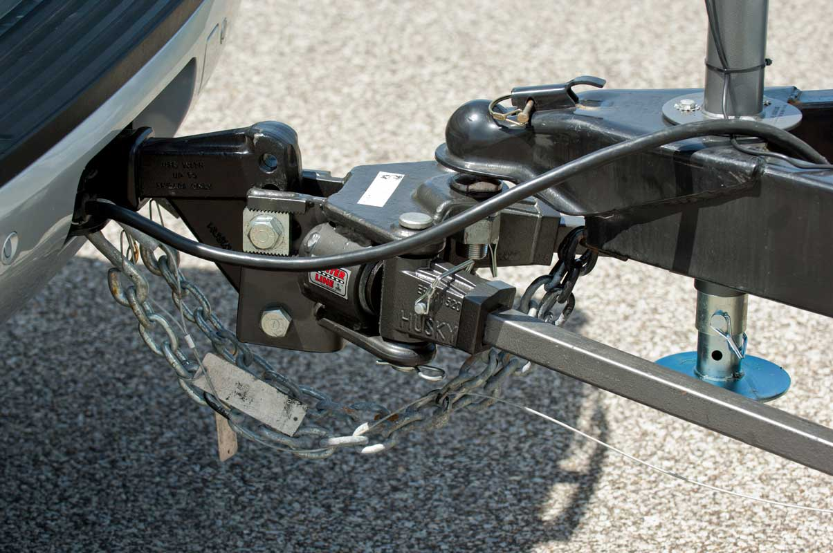 Husky weight distributing hitch for RV travel trailers hooked up to vehicle