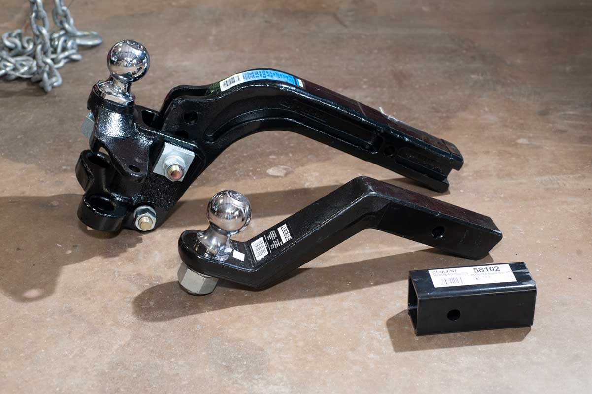 Weight distributing hitches and chain for RV travel trailer towing