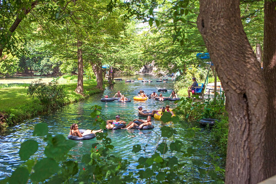 People tubing down the Comal River at water parks