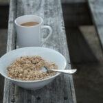 oatmeal on picnic table with coffee mug
