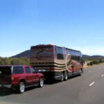 motorhome towing a vehicle using RV tow bars