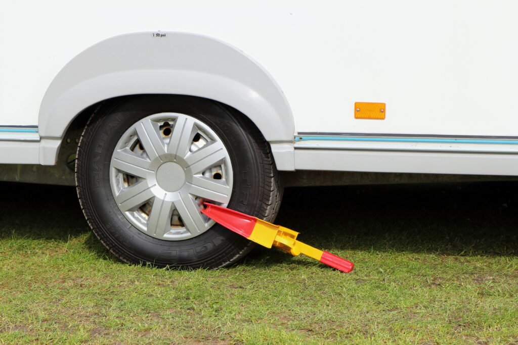 Wheel clamp attached to the wheel of a touring caravan, used to prevent RV theft