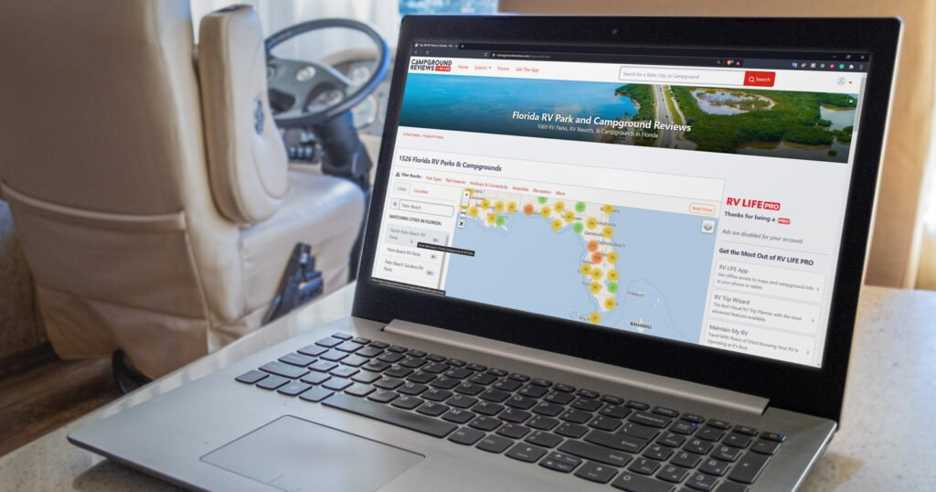Laptop in RV searching Campground Reviews