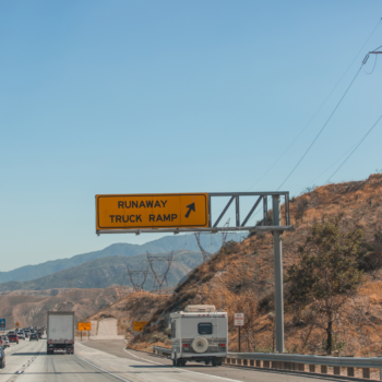 RV entering runaway ramp on mountain road - runaway ramp