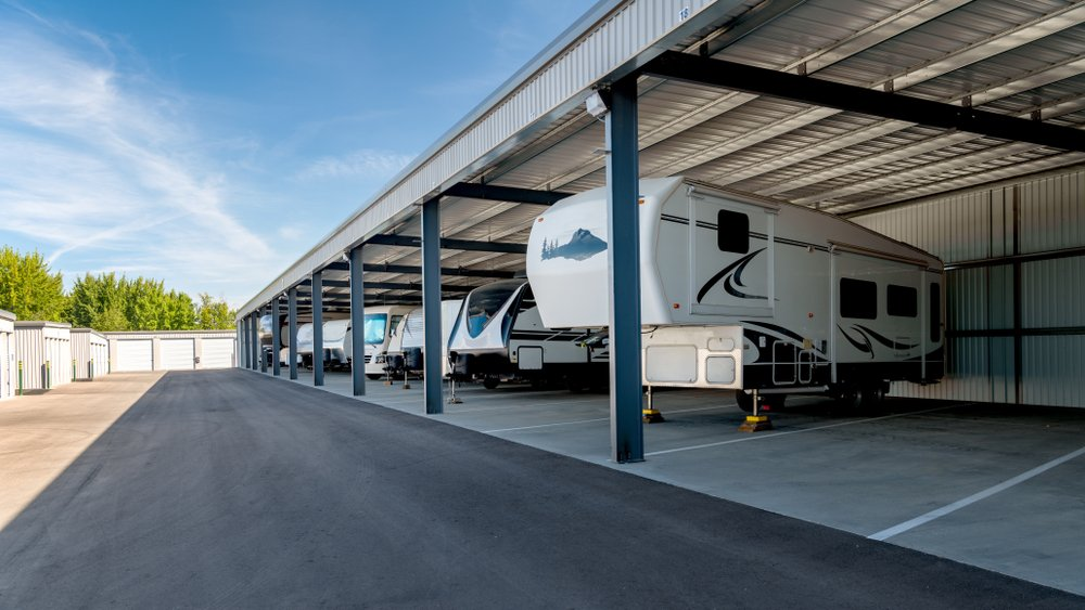 RVs sit in a covered storage facility
