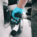 Man fills fuel tank of RV