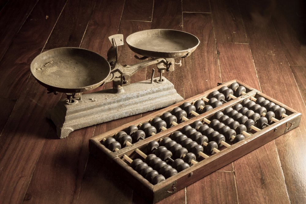 Scales and abacus depict older traditional way of doing things
