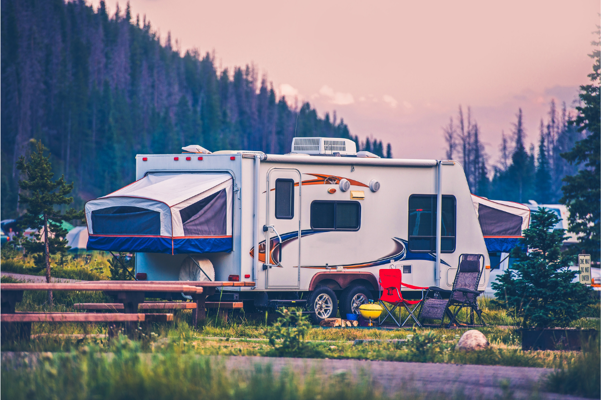 Small travel trailer set up at campground - travel trailer advice for newbies