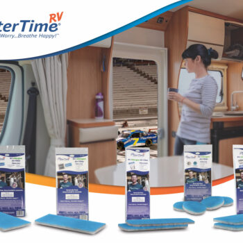 woman in rv watches nascar race forefronted by line of RV air filters