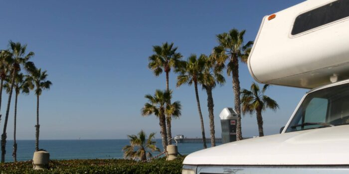 RV travel tips - motorhome and palm trees view