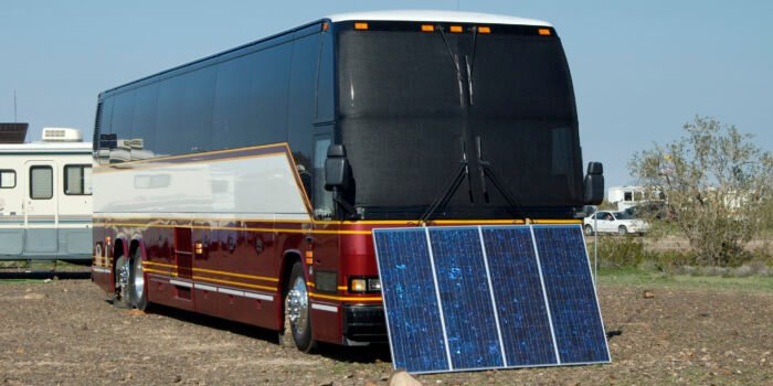 RV solar panels leaned on Class A rig