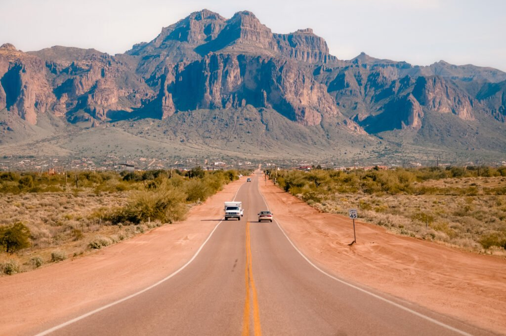 RV driving to RV resorts in Phoenix with mountain view in background