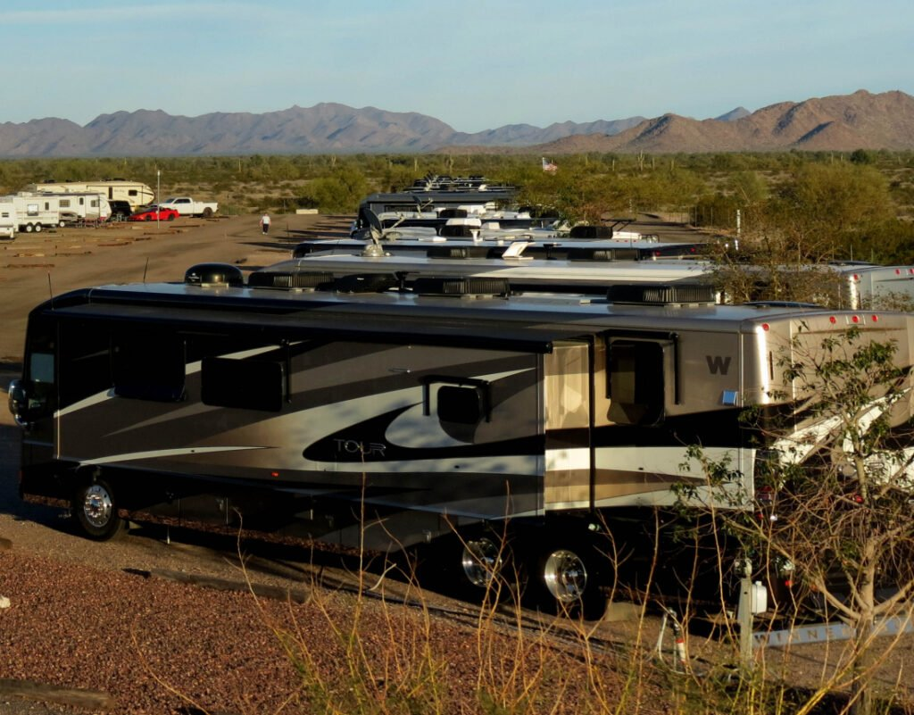 Class A RV in the foreground with mountains on the horizon