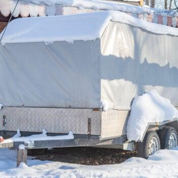 RV covered for winter - RV winterizing checklist